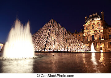 PARIS - JANUARY 1: Louvre Pyramid and Pavillon Rishelieu in...