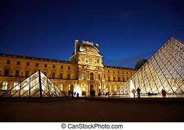 PARIS - JANUARY 1: Louvre Pyramid and Pavillon Denon in the...
