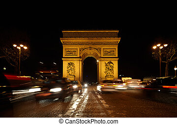 Triumphal Arch on the SDG square at night. Road out of focus. Blurred lighting traces of automobiles.