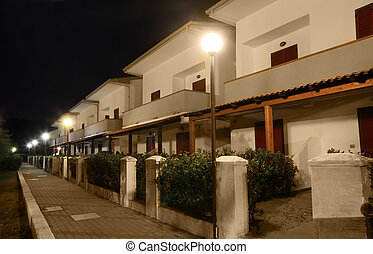 view of building of sanatorium at night. two-storey villas...
