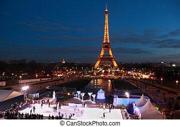 PARIS - JANUARY 2: People skate at night on January 2, 2010...