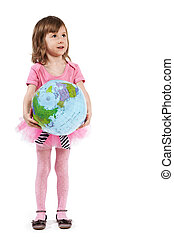 Little girl in pink with the inflatable ball-globe.