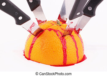 orange - An halved orange with knives and traces of blood
