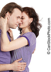 Closeup young couple in violet t-shirts embracing