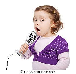 Little girl in violet sings intj the microphone.