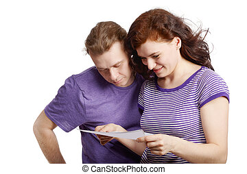 Closeup young man and woman in violet t-shirts view some...