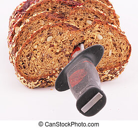 bread - A loaf of bread into slices with a knife