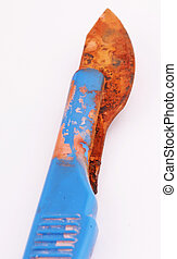 scalpel - A rusty scalpel with blue handle