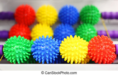 Rows of colorful plastic massagers in store; balls with...