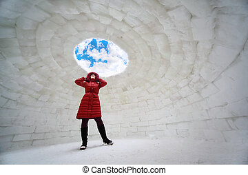 beautiful young woman in red jacket standing inside igloo at...