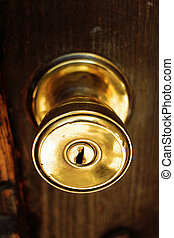 Door knob - golden knob security door that expresses...