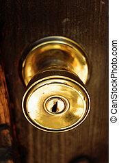 Door knob - golden knob security door that expresses...