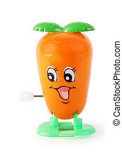 funny toy clockwork orange carrot with face on white background
