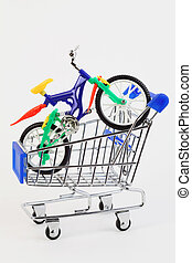 colorful plastic toy two-wheeled bicycle in purchasing cart...