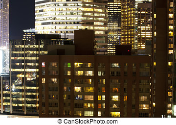 Apartment and Office Lights at Night in City - A view of the...