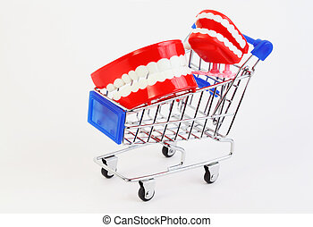 two small toys jaw with white teeth in purchasing cart on...