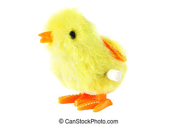 bright toy clockwork fluffy yellow chick with orange feet isolated on white background