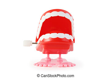 front view of toy clockwork open jaw with white teeth on...
