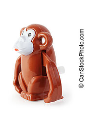 bright toy clockwork brown waggish monkey on white...