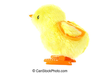 side view of clockwork toy fluffy yellow chick with orange...
