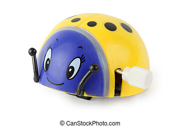 bright toy clockwork yellow ladybird with blue face on white background