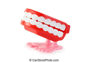 side view of bright toy clockwork jaw with white teeth on...