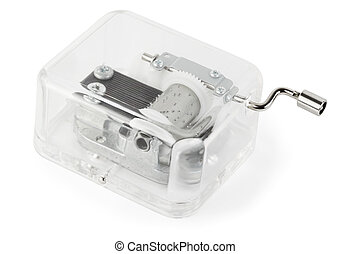 little clockwork toy transparent musical box on white...