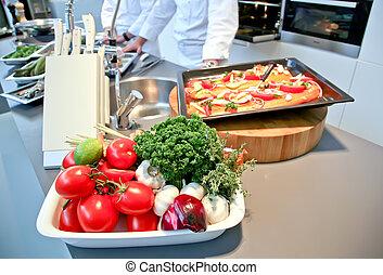 restaurant kitchen - fish dish prepare in restaurant kitchen