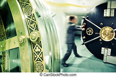 safe door - banker is opening safe door