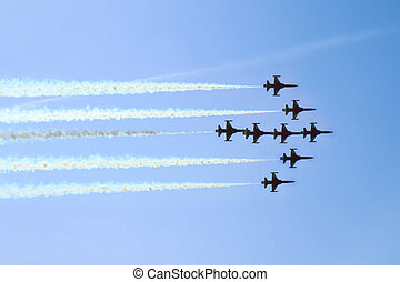 aircrafts on the blue sky in the air show as nice background