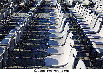 Many rows of gray, plastic chairs. More of this motif and more backgrounds