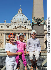 beautiful young mother, little daughter and son on Piazza San Pietro in Rome, focus on mother