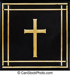 Golden cross, symbol of the Christian faith on the black...