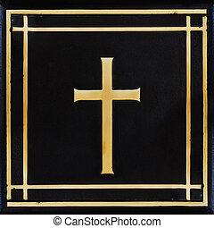 Golden cross, symbol of the Christian faith on the black...