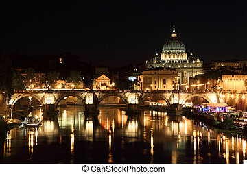 Sant' Angelo Bridge and Basilica of St. Peter at night in...