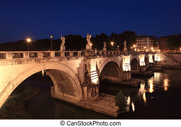 Sant' Angelo Bridge at night, beautiful old sculptures and lanterns