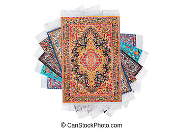 Six rectangular varicoloured carpets lie on spiral on white background