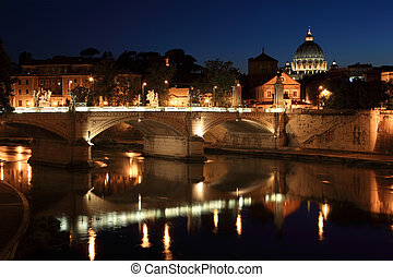 Ponte Vittorio Emanuele II at night in Rome, Italy. beautiful old sculptures and lanterns