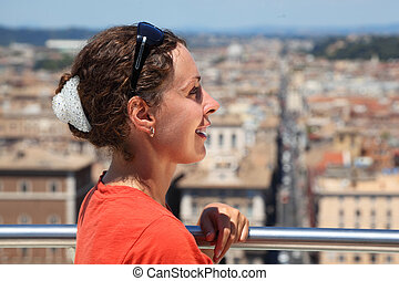 beautiful young woman looks at Rome from Altar of Fatherland in Rome, Italy.