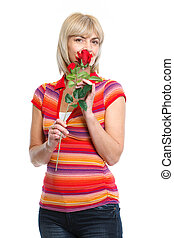 Happy middle age woman smelling red rose