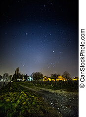 Stars Over Swiss Village - View of a starry skies over a...