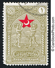 Cherubs upholding star - TURKEY - CIRCA 1932: stamp printed...