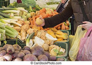 Picking organic vegetables on marke