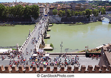 Tourists going on Sant' Angelo Bridge at summer day in Rome,...