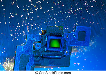 CCD sensor on a card of digital camera with fiber optical background