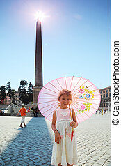 Little beautiful girl near obelisk on Piazza del Popolo in...