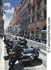 ROME - AUGUST 4: Rows of motorcycles and tourists on streets...