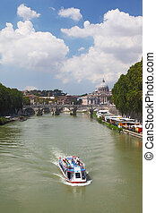 Boat on Tiber river, Sant Angelo Bridge and Basilica of St...
