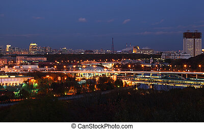 View from Vorobyovy Hills, bridge across Moskva River in Moscow, Russia, at evening
