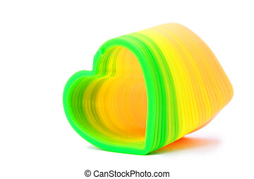 Plastic toy spring in heart-shaped, yellow and green colours